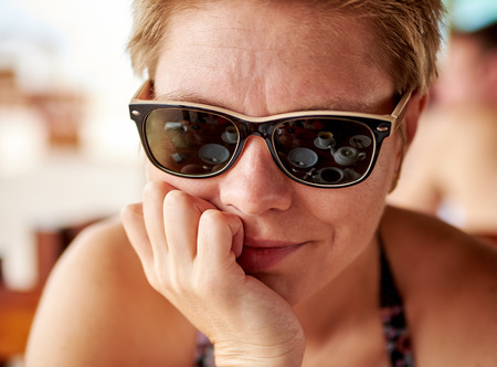blonde bikini: Pretty girl with reflection in sunglasses in a cafe Stock Photo