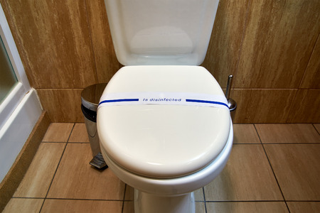 lavatory: Flush toilet lavatory bathroom with disinfected sign Stock Photo