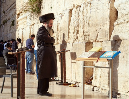 JERUSALEM, ISRAEL - MAY 1, 2015: Western Wall also known as Wailing Wall or Kotel in Jerusalem. People from all over the world come to pray. Its sacred place for all Jewish Jews and Christians.