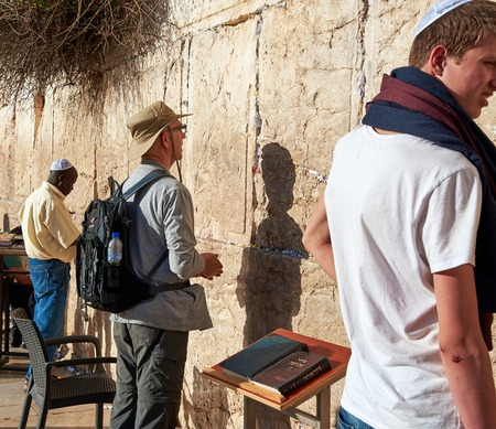 holies: JERUSALEM, ISRAEL - MAY 1, 2015: Western Wall also known as Wailing Wall or Kotel in Jerusalem. People from all over the world come to pray. Its sacred place for all Jewish Jews and Christians.