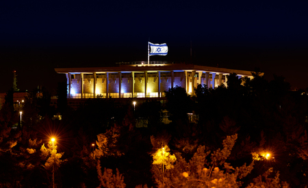 knesset: Knesset the Parliament of Israel with flying waving flag of Israel at night Stock Photo
