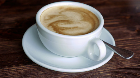 teaspoon: White cup with coffee, saucer and teaspoon on wooden table surface. Close-up. Stock Photo