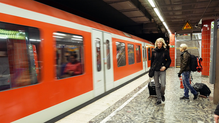 Hamburg, Germany - October, 10, 2016: People at subway metro underground tube station walk to get the arriving train. Passengers use public transportation subway metro system in a big European city.