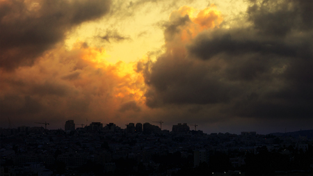 Sunset with huge cumuli clouds over the city. Jerusalem sunset at night dusk. Stock Photo