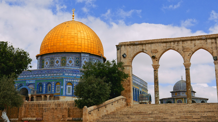 Tourists at the Dome of the Rock in Jerusalem on the top of the Temple Mount. Golden Dome is the most known mosque and landmark in Jerusalem.