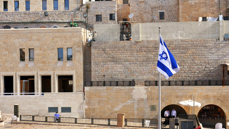 israeli: Israel Flag is waving and flying on the wind. The Flag is located near the Western Wall also called Wailing Wall or Kotel. Jerusalem, Israel.