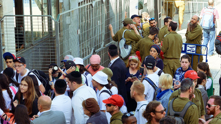 kippah: Jerusalem, Israel - May 25, 2017: People crowd with soldiers and military men entering to Western wall square in Jerusalem. Western wall or Wailing wall or Kotel is the most sacred place for all jews. Editorial