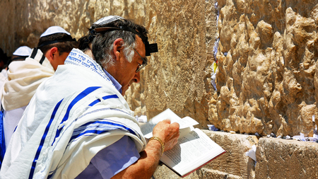 kippah: Jerusalem, Israel - May 25, 2017: Jew haredi pray at the Western Wall also known as Wailing Wall or Kotel in Jerusalem. The Western Wall is the most sacred place for all jews and jewish in the world.