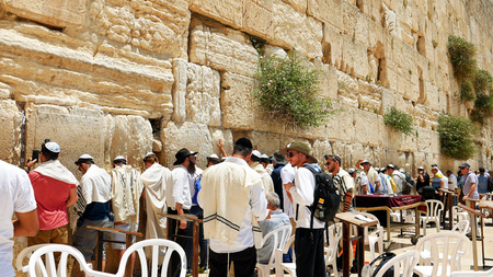 Jerusalem, Israel - May 25, 2017: Western Wall or Wailing Wall or Kotel in Jerusalem. People come to pray to the Jerusalem western wall. The Wall is the most sacred place for all jews in the world. Editorial