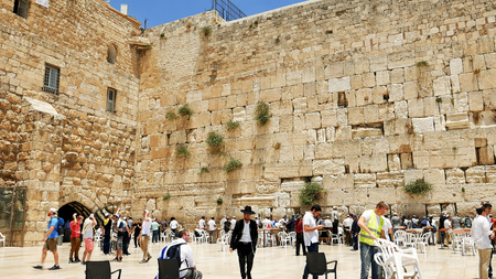 Jerusalem, Israel - May 25, 2017: Western Wall also known as Wailing Wall or Kotel in Jerusalem. The Western Wall is the most sacred place for all christians jews and jewish people in the world.