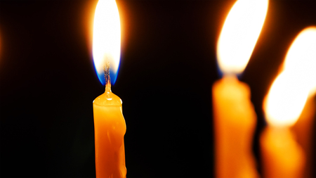 Burning candles. Celebration event or religious memorial attribute of warmth and sincerity. Stock Photo