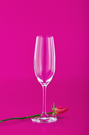 Wine glass with rose flower on pink background Stok Fotoğraf