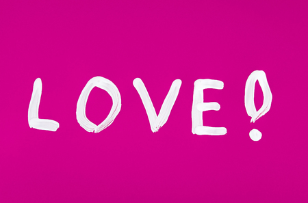 Love word painted on the pink background