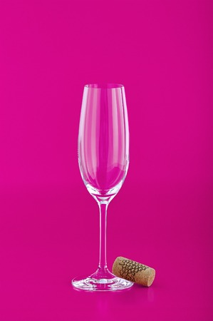 Wine glass with cork on pink background Stock Photo