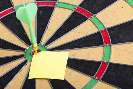 holed: dart hit the centre of target and attaches sticker