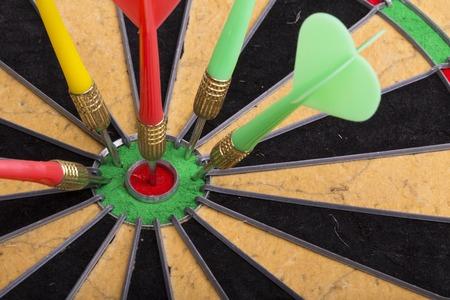 bull     s eye: the darts hit the target on dartboard