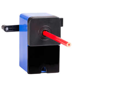 hand crank: Close-up of a blue sharpener with pencil isolated