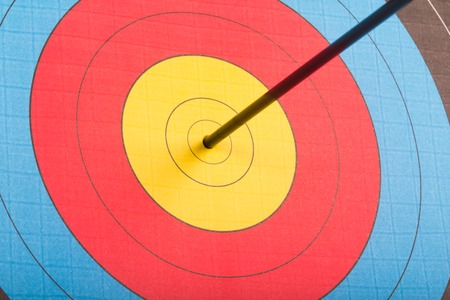 Arrow hit goal ring in archery target isolated Stock Photo