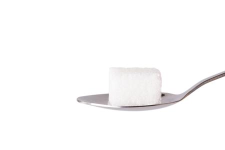 teaspoon: Salt or sugar on a teaspoon isolated on white background
