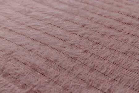 Pink fluffy wool knitted fabric texture.