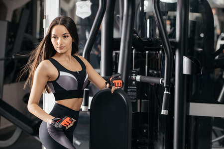 Side view of a beautiful fit girl. Energy fitness-motivation, training, sports, lifestyle concept. Concept of bodybuilding training. Fitness exercises. Copy space