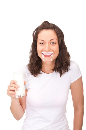 Young lady was taking too much yogurt and now she looks like vampire. Stock Photo - 10817865