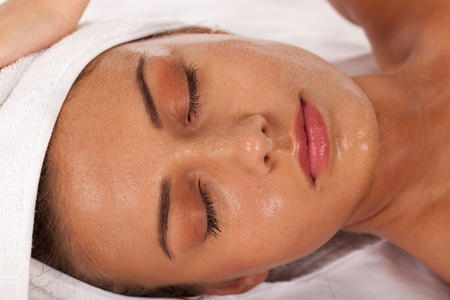 Young girl with beads of perspiration in SPA center. Stock Photo