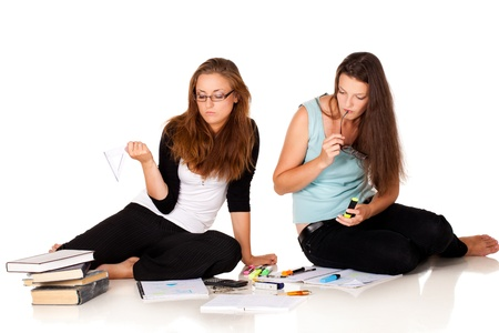 Two students are solving their homeworkNOTE: Isolation with shadows! Stock Photo - 10893499