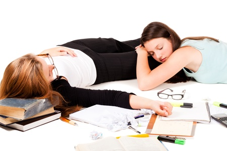 Two students are sleeping after hard night of study.NOTE: Isolation has shadows! Stock Photo - 10893500