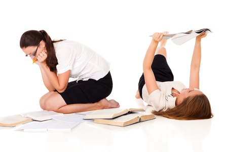 Two students are preparing for the exams. One has books, other - beauty magazine. Who will get a better mark?NOTE: Isolation with shadows! Stock Photo - 10930454