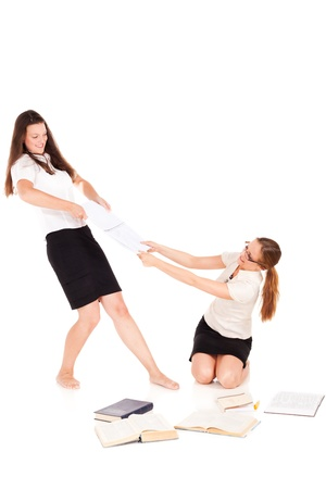 Two students are fighting for note book.NOTE: Isolation has shadows! Stock Photo - 10930459