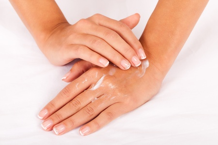 Take care of your hands with pleasure (on a white cotton textile). photo