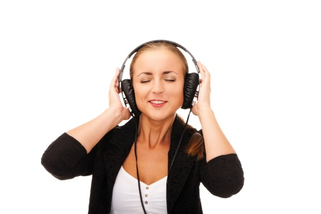 Girl with headphones and eyes closed on isolated white background Stock Photo - 11071743