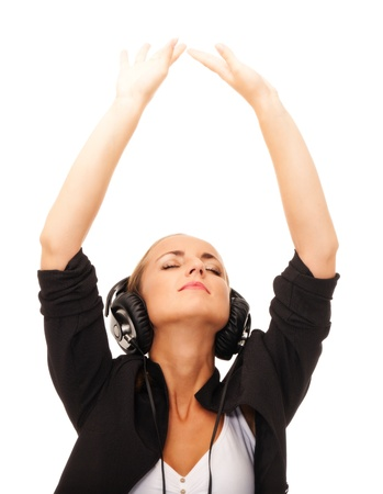 Girl with headphones and eyes closed on isolated white background