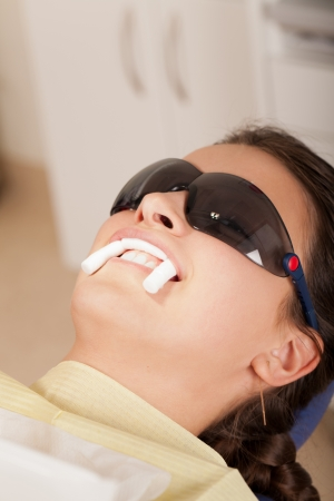 Smiling patient with tampons in teeth Stock Photo - 11119317