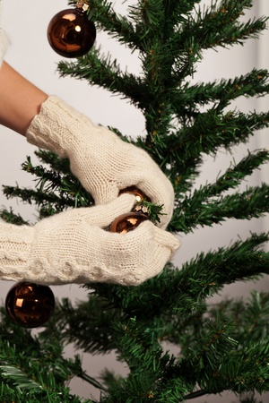 tried: Have you tried to decorate fir tree with mitten? Stock Photo