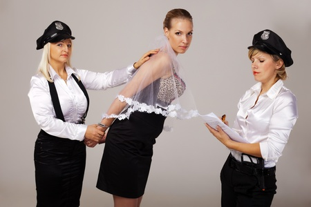 Hen party mates are taking fiancée under arrest. Stock Photo
