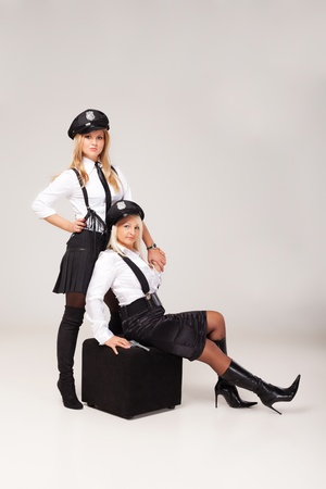 Fiancée's party mate are playing in morality police. Stock Photo - 11217479