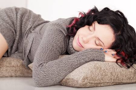 Beautiful girl in sweater is sleeping and having sweet dreams Stock Photo