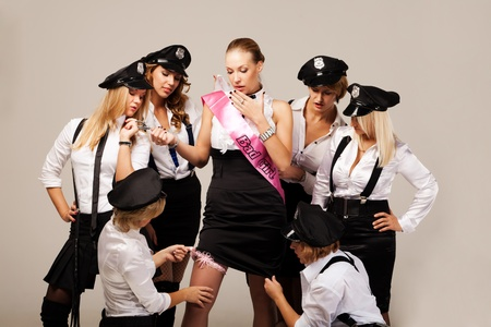 Party mates playing police officers photo
