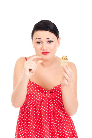 Young woman in ladybug-like dress and small boxed present Stock Photo - 11396428