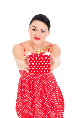 Young woman in ladybug-like dress and boxed present photo