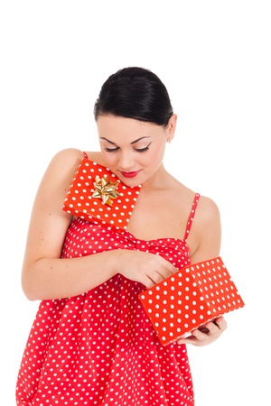 Young woman in ladybug-like dress and boxed present Stock Photo - 11396458