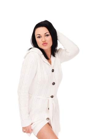 Young woman in white knitted dressing gown on isolated white background Stock Photo - 11639905