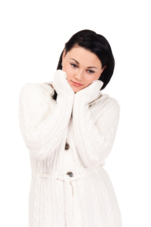 Young woman in white knitted dressing gown on isolated white background photo