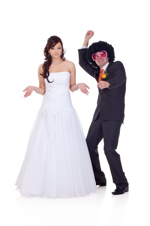 wig: Bride is wondering who is the guy she did marry, because he looks like a disco dancer.