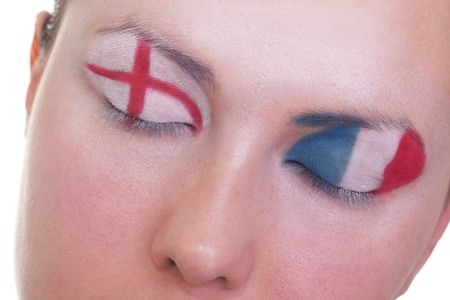 Young girl is dreaming about score in match between England and France: EURO 2012, group D, 11th of June. Focus on eyelashes. Stock Photo - 12509880