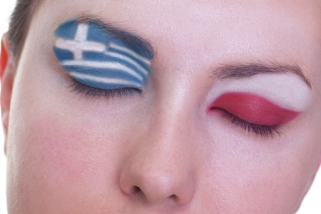 Young girl is dreaming about score in match between Greece and Poland: EURO 2012, group A, 8th of June. Focus on eyelashes. Stock Photo - 12509890