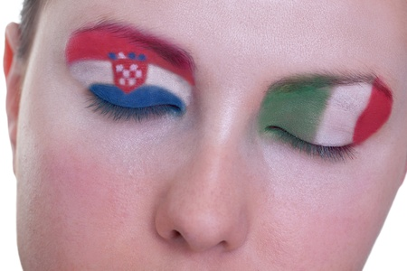 Young girl is dreaming about score in match between Croatia and Italy: EURO 2012, group C, 14th of June. Focus on eyelashes. photo
