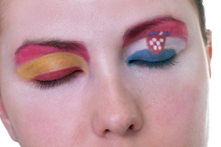 Young girl is dreaming about score in match between Spain and Croatia: EURO 2012, group C, 18th of June. Focus on eyelashes. photo